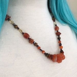 Amber brown beaded necklace. Heavy and rich.